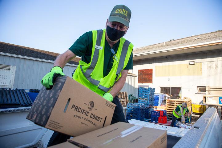 Man loads food box in truck