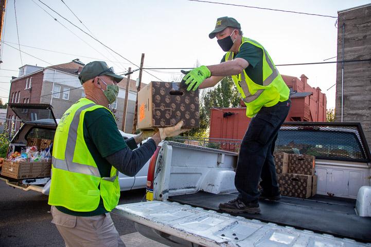 Men load food in truck